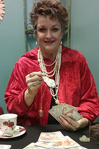 photo of a fortune teller with cards