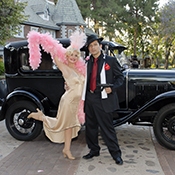 female flapper with gangster with model A car