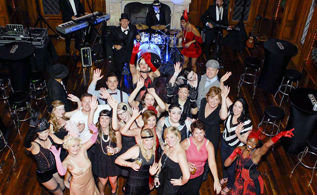 Crowd enthusiastically enjoying a 20s theme party