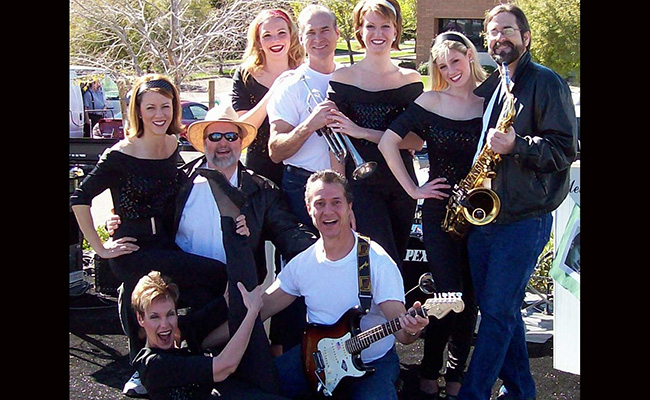 nine talented musicians singers and dancers posing in fifties attire