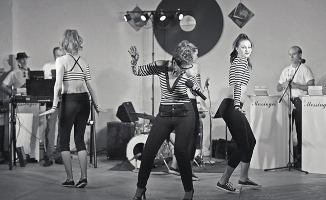Singer and dancers performing Jailhouse Rock