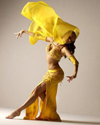 female belly dancer in yellow costume