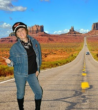 Girl hitch-hiking on route 66