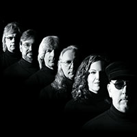 headshot of six musicians black and white
