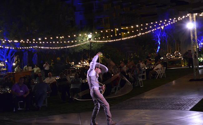 Lasso artist with performing lights