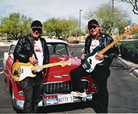 two twin musicians with guitars and classic fifty five chevy