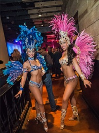 Two Samba Greeters dressed in feathers and jewels