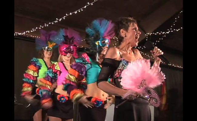 photo of mardi gras singers and dancers