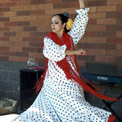 costumed female spanish flamenco dancer