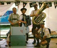 female accordionist with three male oktoberfest musicians