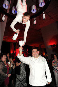 aerial bartender serving wine to chef