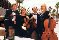 four classical musicians with instruments