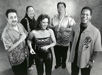 four latino musicians and female singer