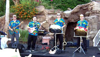 four male musicians with steel drum and guitars in blue shirts