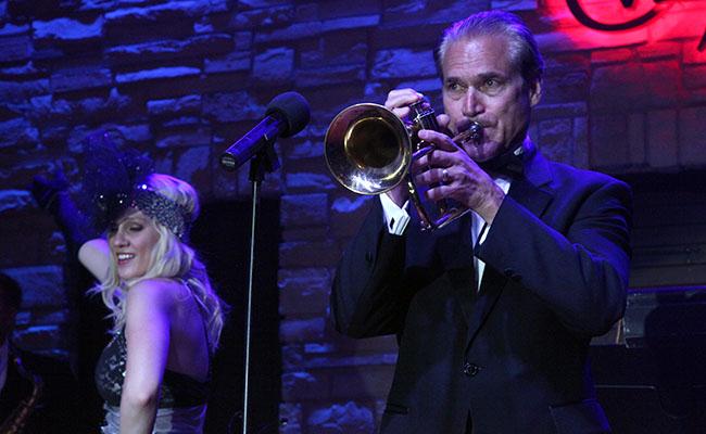 male trumpet soloist with female cabaret dancer