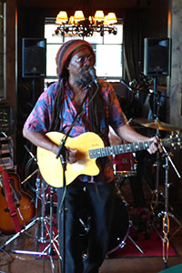 picture of a solo caribbean reggae singer