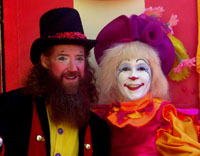 costumed male and female happy clowns