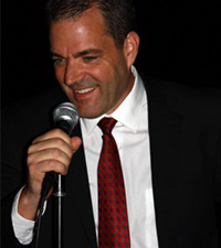 close up of male comedian with microphone