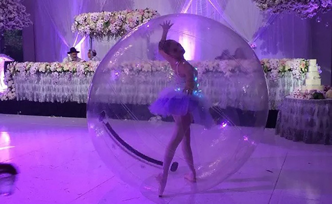 Photo of aerialist in bubble