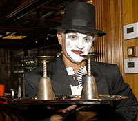 male white face mime with hat and tray