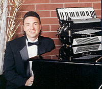 male pianist in tuxedo with accordion sitting on piano