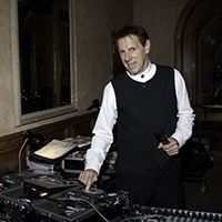 DJ with keyboard and mixing equipment