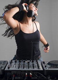 dancing female dj with ear phones and console
