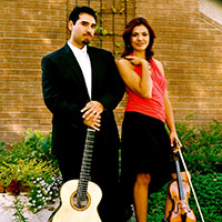 standing male guitarist and female violinist