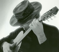 male classical guitarist with flat brimmed Spanish hat