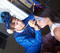 female face painter dressed in blue