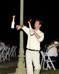 male Flair Bartender juggling fire bottles
