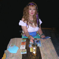 blonde fortune teller behind table
