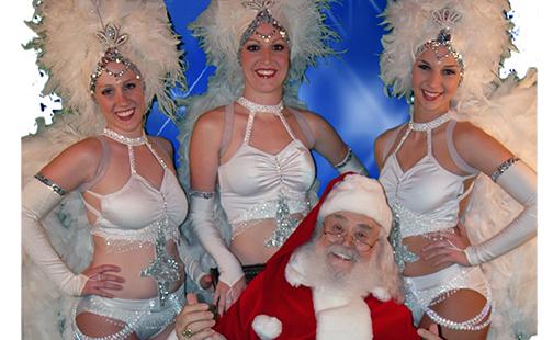 glamorous dancers with Santa