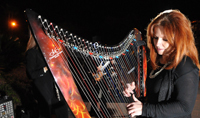 female harpist performer with red hair