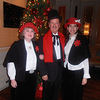 photo of holiday carolers