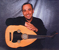 smiling male musician with Oud instrument