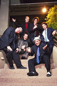 six male musicians in suits