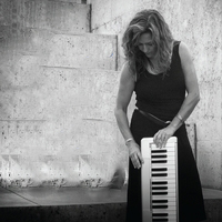 female with keyboard dress in black