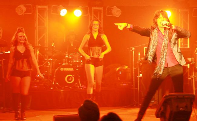 Mick Jagger impersonator singing on stage