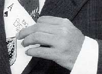 close up of magician's hand with playing card