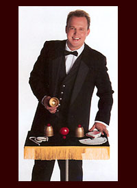 magician with props on magic table