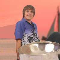 male singer on beach with steel drum