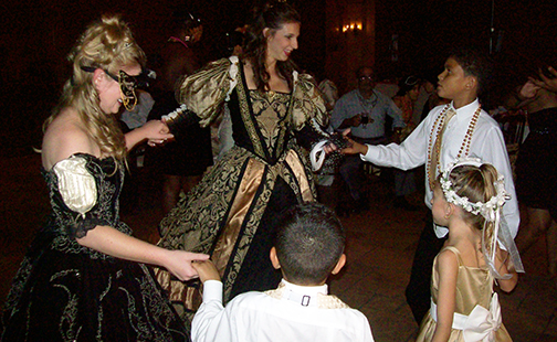 Masquerade dancers interacting with the crowd
