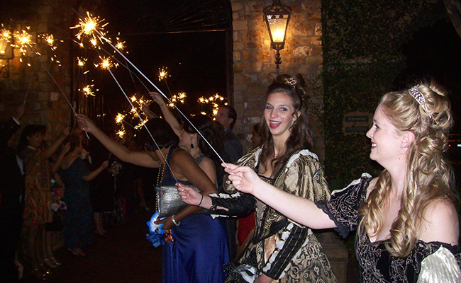 beautiful renaissance costumed greeters with sparklers