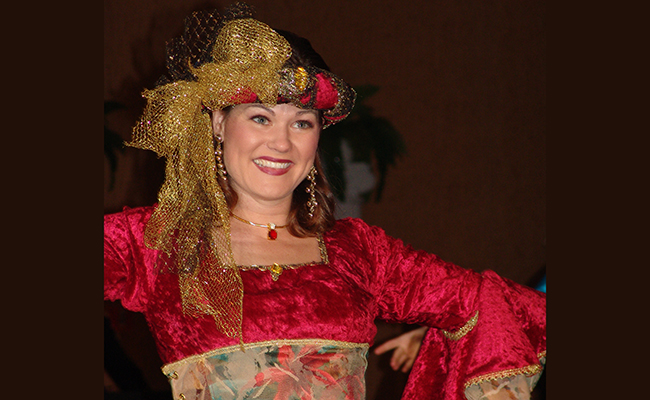 beautiful smiling renaissance performer in red and gold