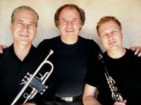 three male jazz musicians with instruments