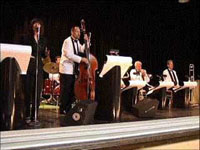 big band in white jackets with instruments