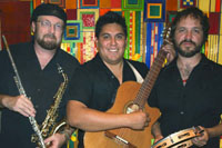 three hispanic male musicians with instruments