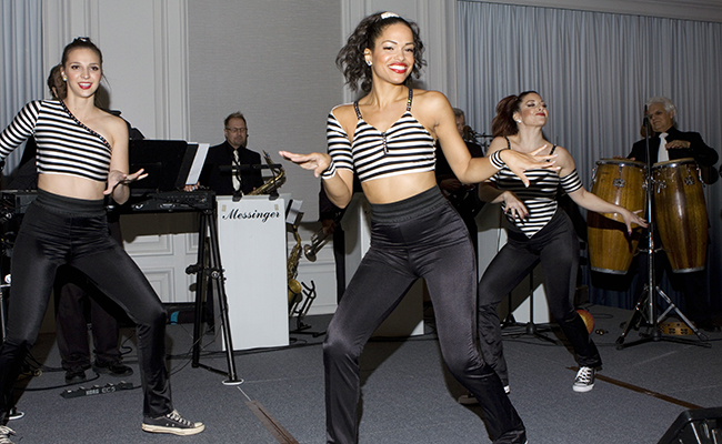 Singer and dancers perform Jailhouse Rock