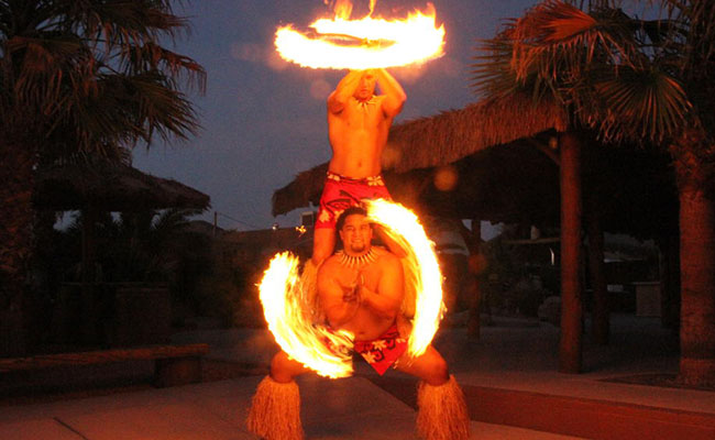two male polynesian fire knife dancers